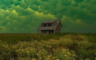 Green mammatus clouds, which usually precede a tornado, over an abandoned house... 3