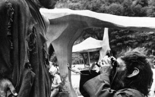 Charlton Heston being photographed by Roddy McDowall behind the scenes on Planet... 3