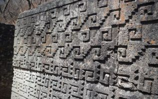 Megalithic blocks and intricate mosaic fretwork seen at Mexico's cruciform cham... 5