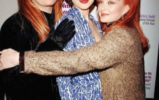 Naomi Judd with her daughters Wynonna and Ashley.... 4