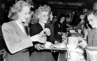 Rita Hayworth and Marlene Dietrich serving the troops at the Hollywood Canteen d... 2