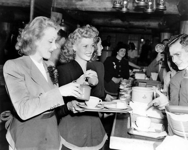 Rita Hayworth and Marlene Dietrich serving the troops at the Hollywood Canteen d... 1