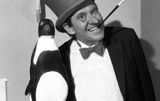 Burgess Meredith as The Penguin.... 3