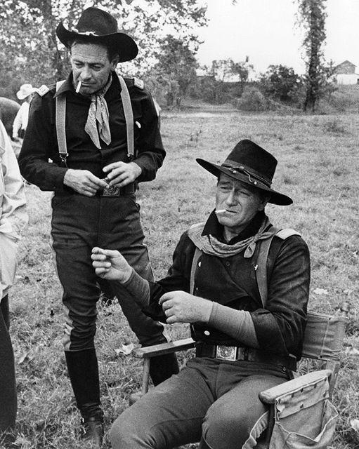 John Wayne and William Holden photographed by John R. Hamilton.... 1