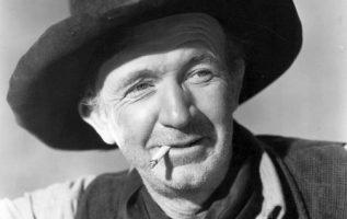 Walter Brennan (July 25, 1894 – September 21, 1974). He is in a short list of me... 3