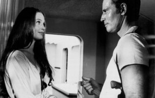 Leigh Taylor-Young and Charlton Heston in Soylent Green (1973)....