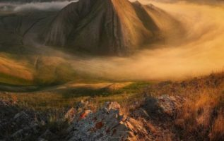 Morning fog in the Ural mountains, Russia...